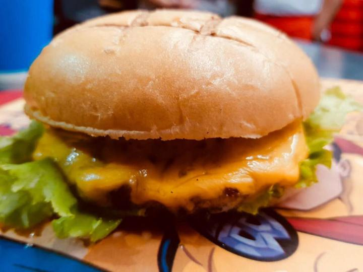 Mouth-watering Captain Barbell double cheeseburger, available at Heroes Burger