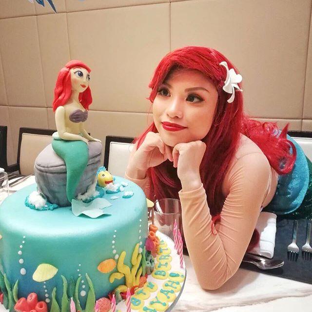 Ariel with custom cake by Marriott Cafe Bakery