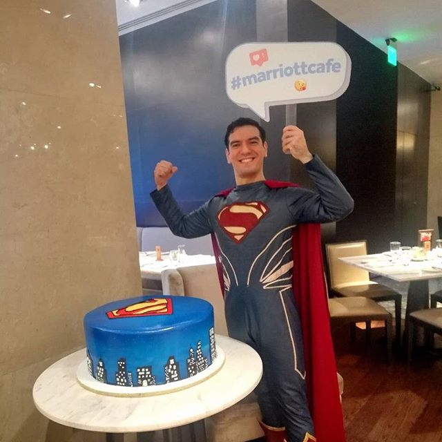 Superman with custom cake by Marriott Cafe Bakery